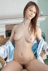 Beata Undine showing her hairy pussy