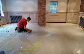 how to lay floor tile on a concrete floor with an uneven surface