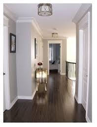 dark wood floors with light gray walls