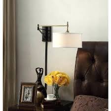 hardwired swing arm sconce antique brass and bronze swing arm wall sconce fixture george kovacs reading room hardwired swing arm wall lamp