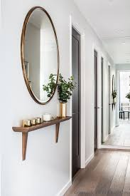 hallway table and mirror. Like The Shallow Shelf. Maple Building \u2013 Gordon Duff \u0026 Linton. View Of Hallway With Bespoke Shelf And Bronze Trimmed Round Mirror. Table Mirror E