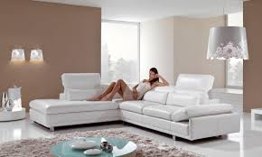 living room white leather sofa with short silver legs placed on the white floor plus