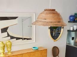 diy wicker pendant lamp of a woven basket via architecturaldigest com
