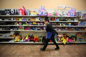 a worker walks past toys at the goodwill located at 1390 american pacific