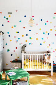 Gender Neutral Nursery With Polkadot Wall