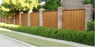 wood fence with stone columns