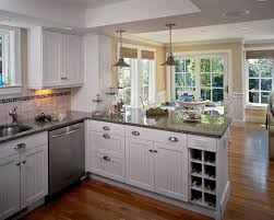 peninsula lighting. kitchen peninsula with nickel cabinet and drawer knobs traditional double glass doors lighting