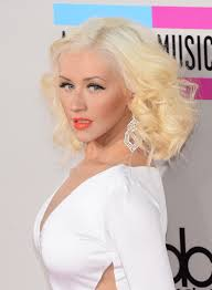 christina aguilera was flawlessly made up with a bright c lip color and shimmery eyeshadow