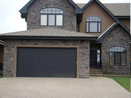 black garage doorscool black garage door also stone wall material and contemporary