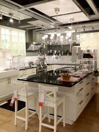 Kitchen Showroom White Cabinetry With Granite Countertopin Also Panel Appliances