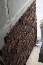 tin brick facade wrought iron doors