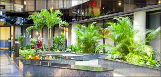 Interior landscaping office Planters Studies Show That When Plants Are Part Of The Interior Landscape In Shopping Centers Hotels Office Buildings Banks And Airports There Are Tangible Evergreen Interiors Inc Bringing The Outdoors In Large Scale Interior Design Beneva