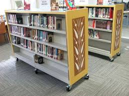 design movable bookshelf mobile shelving helps libraries to open up space really like the movable bookshelf
