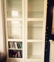 ikea besta white display cabinet bookshelf with glass doors