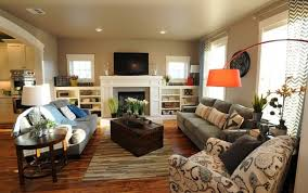 orange floor lamp and white fireplace for beautiful family room ideas with cream colored wall