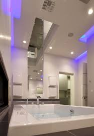 bathtub lighting. Luxury Bathroom Themed Feat Agreeable Blue Led Lights In Ceiling Over Elegant Vanity And Jacuzzi Bathtub With Stainless Faucet Lighting