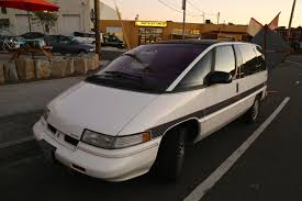 OLD PARKED CARS.: 1990 Oldsmobile Silhouette.
