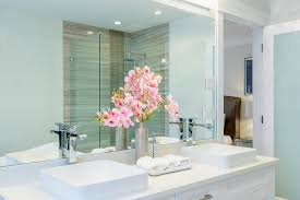 Folded hanging towel Pocket Luxury Hotel Bathroom With Orchids And White Folded Hand Towels Next To The Sink Sobel Westex How To Fold Bath Towels Like Hotel Fun And Easy Folding Ideas