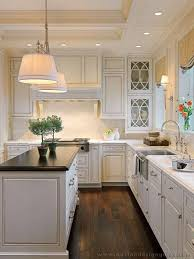 Light sconces by sinkwhite cabinets dark floors Home