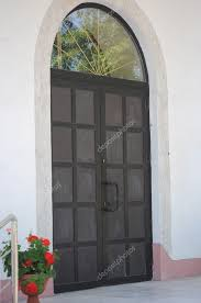 modern wooden door with glass panes and arches stock photo