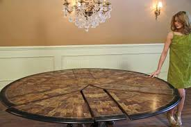 expandable round dining table shown at 84 inches slide pie cut panels back towards the center until leaves and panels are snug
