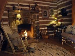 a very nice fireplace in an obviously older log cabin most log cabins and homes today do not have this much ing between the logs