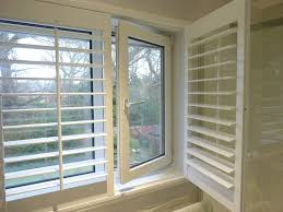 inward opening window with shutters