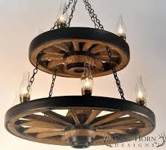 wagonwheel chandeliers large wagon wheel chandelier with lanterns