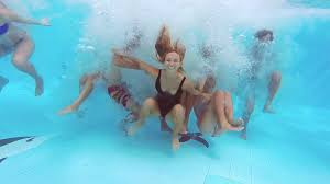 swimming pool with friends. Beautiful Swimming Underwater View Of Happy Fun Loving Group Friends Jumping And Diving  Into Swimming Pool At A Party In Summer Sunny Day Slow Motion Intended Swimming Pool With Friends
