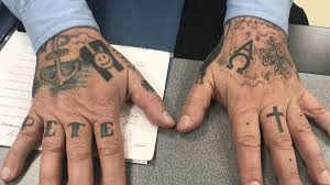 Should Police Officers Be Policed On Concealing Their Tattoos