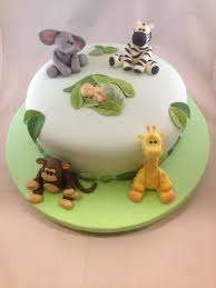 Yellow Blue And Green Jungle Baby Shower Cake And Cupcakes Baby Shower Safari Cakes