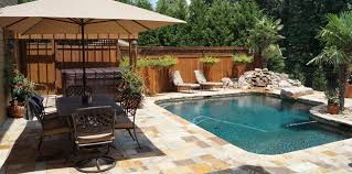 custom stone and brick swimming pool patio and deck company