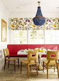 a custom red leather bench seat adds a burst of energy to this dining area in this design less red is more the bold punch of color entertains the eye