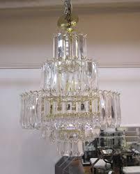 a beautiful seven tier nine light vintage modern lucite wedding cake