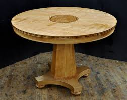 a custom round cherry dining table
