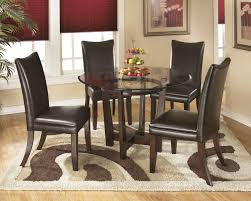 charrell round dining room table 4 um brown uph side chairs