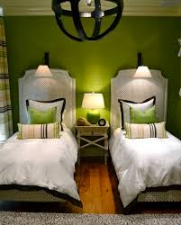 View in gallery Green guest room with matching accent pillows for twin beds