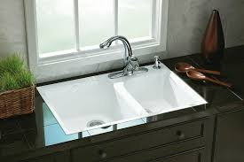 a tile in cast iron kitchen sink is a drop in style