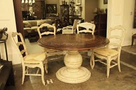 antique white round kitchen table with wooden top plus 4 antique white chairs with rattan wicker