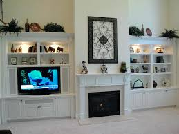 fireplace cabinet ideas elegant white cabinets and shelves with full of decorative items and set modern fireplace cabinet ideas