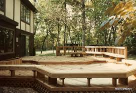 cedar multi level deck with floating standard and tree surround benches