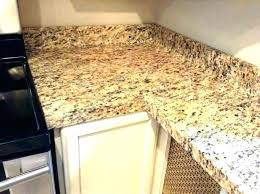 thin granite overlay unclog a kitchen sink drain naturally faucet side spray countertops diy g