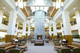 Futuristic Loby Interior Design With Stone Fireplace Wall Idea