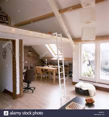 mezzanine floor office. Pale Wood Dining Table And Chairs In Small Loft Conversion With Wooden Flooring Ladder Up Mezzanine Floor Office