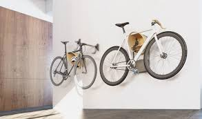 cova bike rack with shelf making use of the vertical wall space this wall mounted bike rack has enough space for all your bike and cycling gear