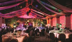 Christmas parties in London by area  Venue Directory - red dining room at  Barbican Roof Gardens