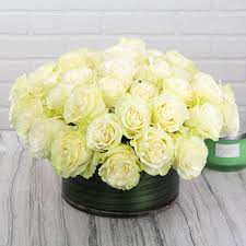 4 dozen white roses in a glass bowl