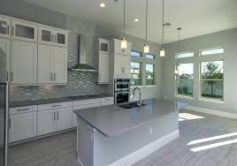 gray and white kitchen contemporary kitchen with white cabinets gray island counter pendant lighting and gray gray and white kitchen