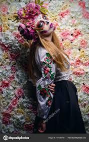 woman with sugar skull makeup on a fl background calavera catrina photo by prometeus