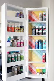 diy swing out wall storage cabinet with open shelving perfect for craft room organization